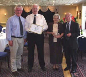 Photo: Alan Johns being presented with a long service award